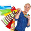 Stock Photo: Womwith shopping bags while shopping