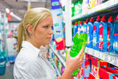 Woman buying cleaning supplies — Stock Photo