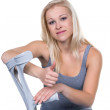 Woman with crutches — Stock Photo #32984493