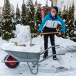 Shoveling snow in winter — Stock Photo #32984579