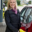 Womat refuel at petrol station — Stock Photo #32984737