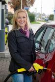 Woman at refuel at petrol station — Stock Photo