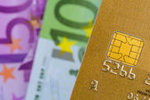 Credit card and euro banknotes — Stock Photo
