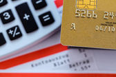 Credit card, bank statement and calculator — Stock Photo