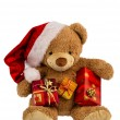 Teddy bear with christmas gifts — Stock Photo