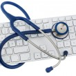 Stethoscope and keyboard of a computer — Stok fotoğraf