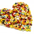 Stock Photo: Colorful pills in heart shape