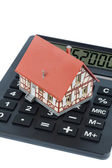 Residential house on calculator — Stock Photo