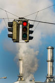 Industrial chimney and red traffic lights — Stock Photo