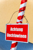Warning sign, warning roof avalanches — Stock Photo