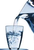 Vaso con agua y jarra — Foto de Stock