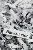 Shredded paper bank customers — Stock Photo