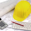 House plan with a construction worker's helmet — Stock Photo #38098463