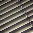 Stock Photo: Venetiblinds for shade at window