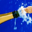 Corks and champagne bottle — Stock Photo