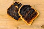 Burned toast bread slices — Stock Photo