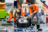 Computer board and construction workers — Stock Photo