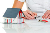 Woman signs purchase agreement for house — Stock Photo