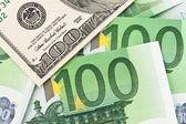 Euro banknotes and dollar. — Stock Photo