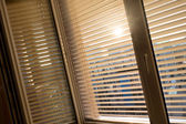 Venetian blinds for shade at the window — Stock Photo