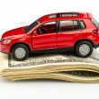 Car on dollar bills — Stock Photo #38802861