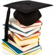 Mortarboard on books stack — Stock Photo #38802991