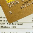 Stock Photo: Credit card and bank statement