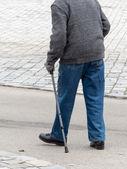Man with walking stick — Stock Photo