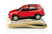 Car on dollar bills — Stock Photo