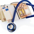 Foto Stock: Stethoscope and euro banknotes,