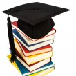 Mortarboard on books stack — Stock Photo #39268085