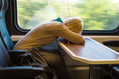 Sleeping woman in train — Stock Photo