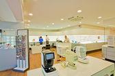 Optometrists, customers and staff — Stock Photo