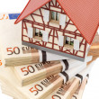 Half-timbered house on euro banknotes — Stock Photo