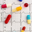 Stock Photo: Tablets on ecg