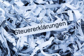 Shredded paper tax returns — Stock Photo
