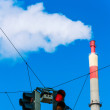Stock Photo: Industrial chimney and red traffic lights