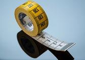 Yellow measure tape — Stock Photo