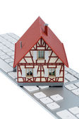 Residential house on keyboard — Stock Photo