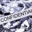 Stock Photo: Shredded paper confidential