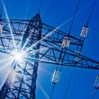 Power line with sun — Stock Photo