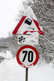 Traffic signs and snow — Stock Photo