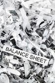 Shredded paper balance sheet — Stock Photo