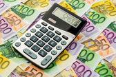 Calculator and euro banknotes — Stock Photo