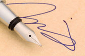 Signature and fountain pen — Stock Photo