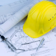 House plan with a construction worker's helmet — Stock Photo