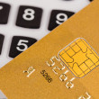 Stock Photo: Golden credit card and calculator