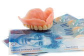 Dentition and the swiss franc — Stock Photo