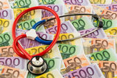 Stethoscope and euro bills — Stock Photo