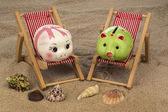Deck chair with piggy bank — Stock Photo